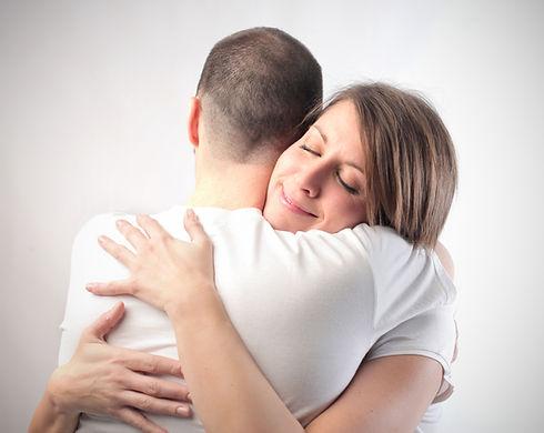 Smiling woman hugging her husband.jpg
