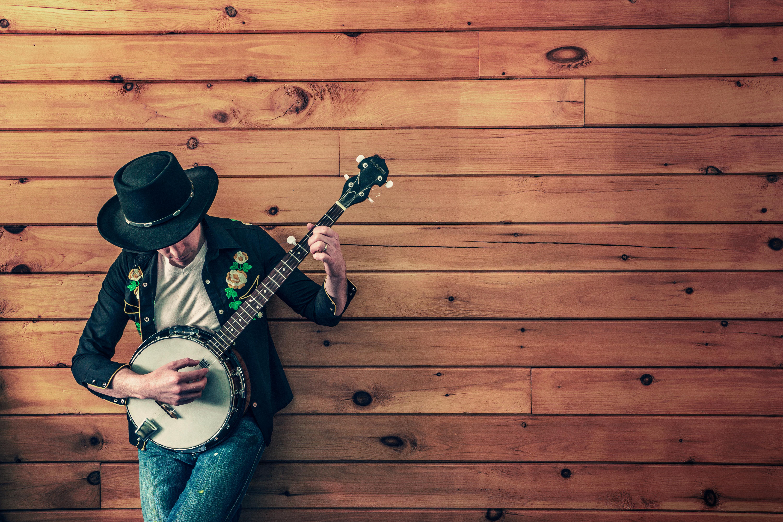 man holding banjo