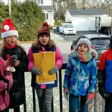 Christmas Caroling raises over $500 for the West Island Women's Shelter