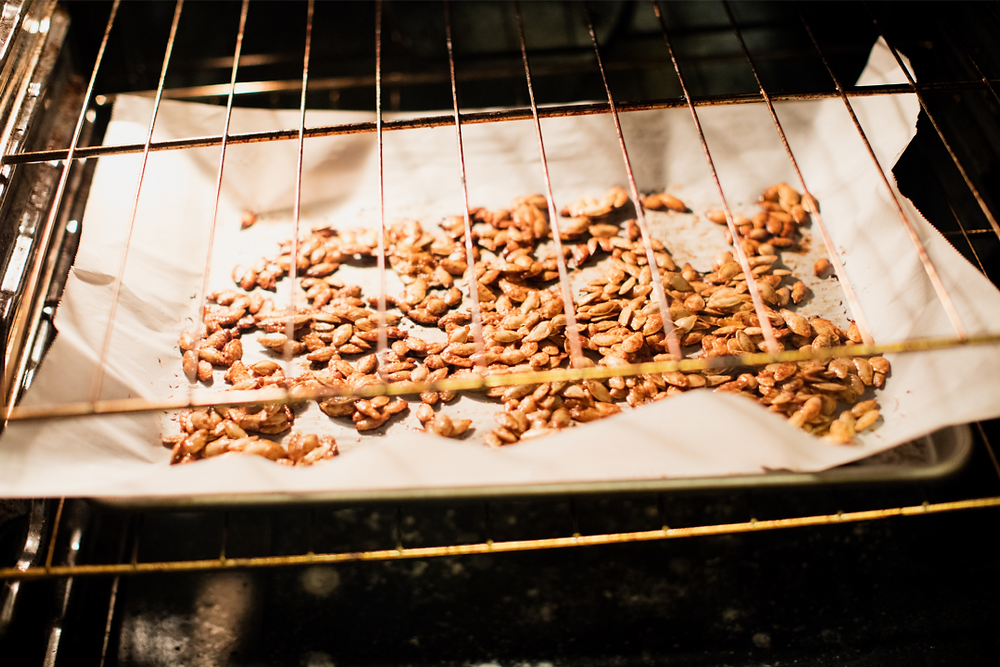 quick and easy homemade roasted pumpkin seeds fun family halloween activity. sweet and salty snack treat.