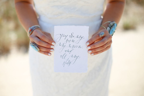 bride holding wedding calligraphy