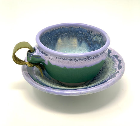 "Michelle Tanberg  Tea Cup, Saucer  Ceramic, Leather   2.5x3.5"" cup, 5.5"" sauce"