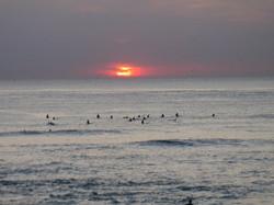 Surf et couché de soleil