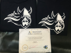 Augustana University T-Shirts and 4 Single Game Tickets for a Men's Basketball game.