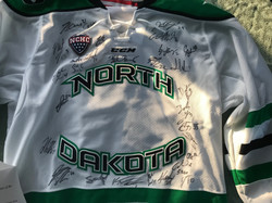2019-20 Team Signed (with COA) UND Fighting Hawks Hockey Jersey