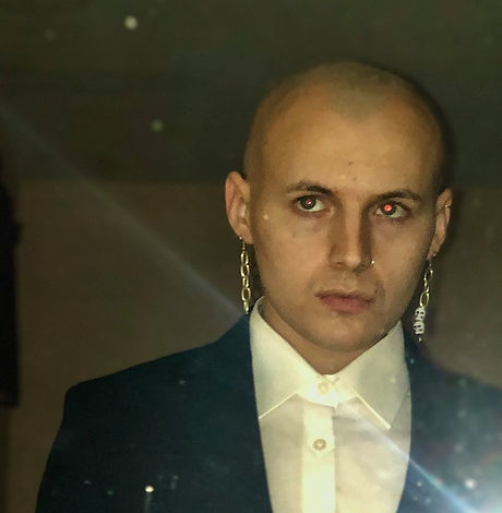 Bald man with earrings.