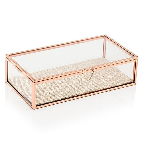Boîte à bijoux en verre avec des bords en or rose
