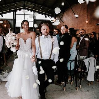 Newlyweds walking back down the aisle