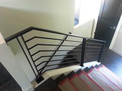 R52 - Contemporary flat bar guard railing powder coated black.jpg