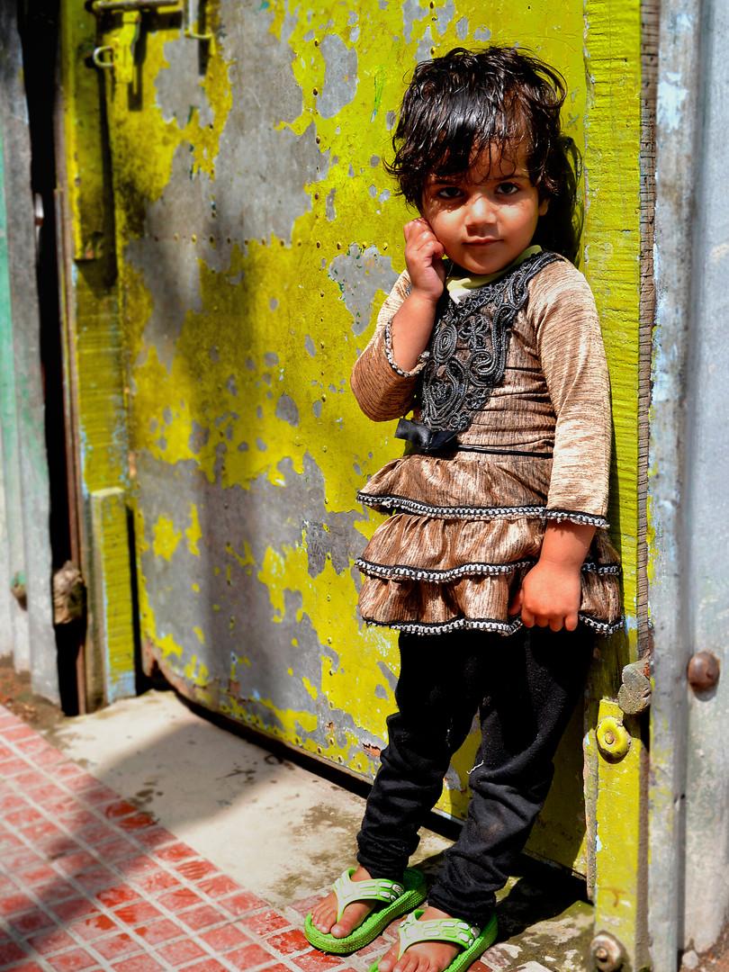Girl and yellow door
