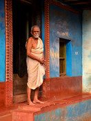 Man with blue house