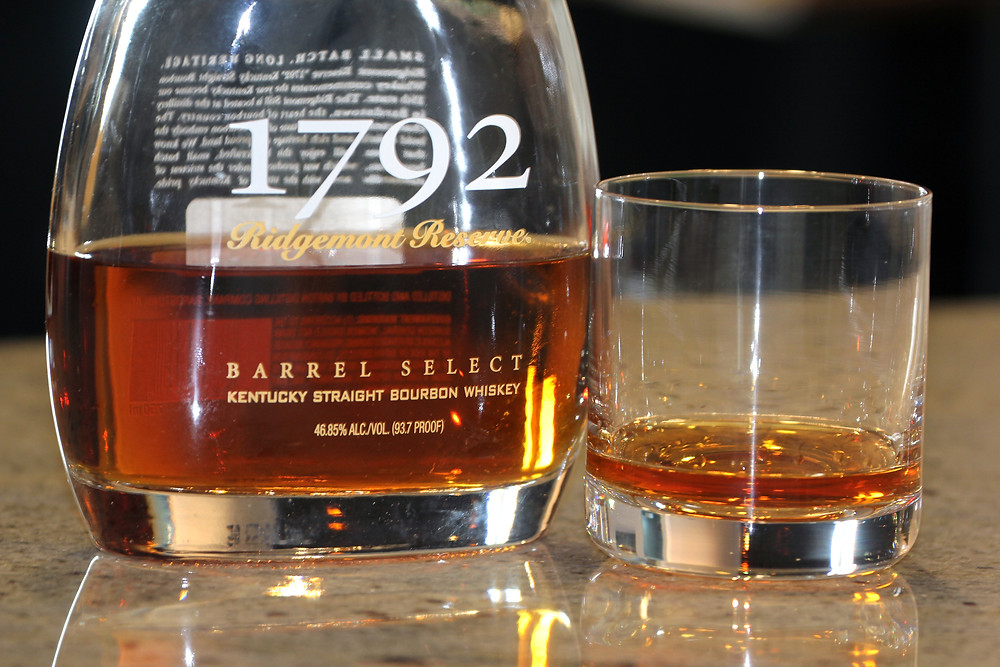 Close up image of a bottle of 1792 bourbon with a small pour in a glass next to the bottle.