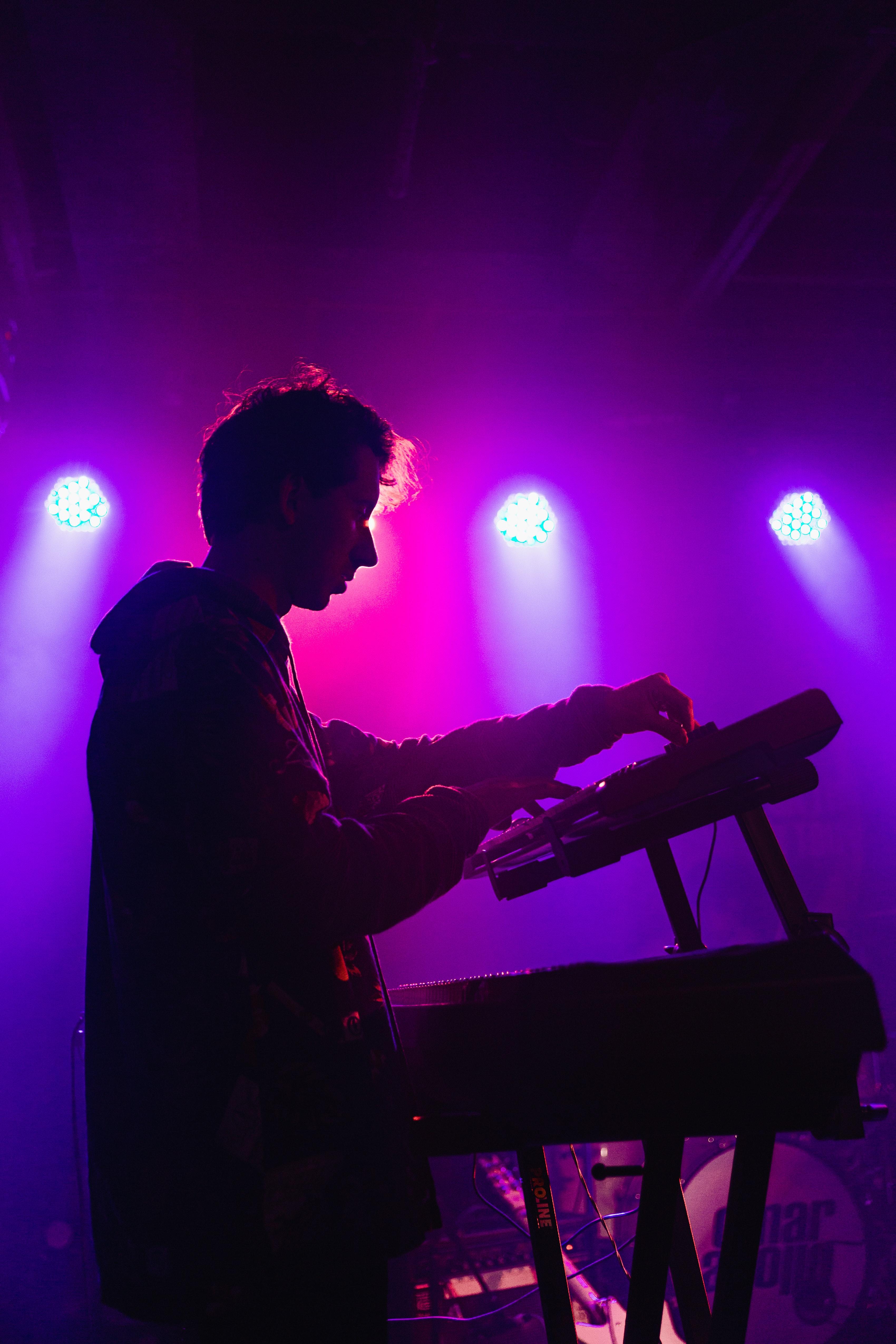 man-holding-dj-mixer-machine-2350325