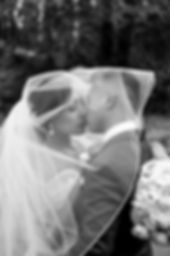 Calistoga Ranch wedding enLuce Photography wedding couple kissing undernath bridal veil