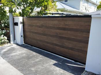 Automatic sliding gate. Cedar inserts oi