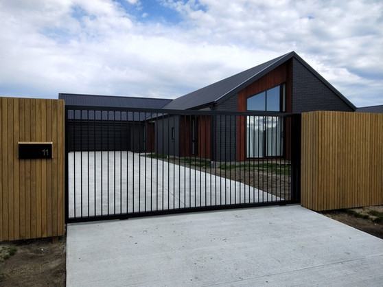Sliding gate. Open, sleek, modern, conte