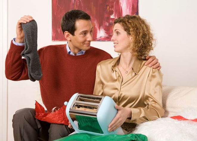 Couple-sitting-on-sofa-holding-toaster-a