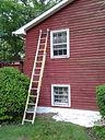"""""""BEFORE"""" painted house exterior."""