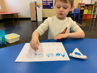 Learning how to write the letters of the alphabet by painting!