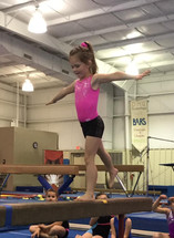 Performing her beam routine!