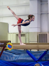 Holding an arabesque on the beam!