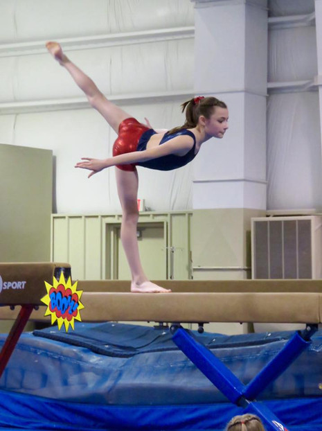 Holding an arabesque on the beam!