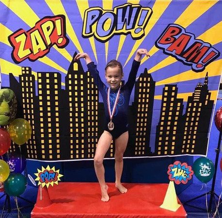 Posing with her Gymlympics medal!