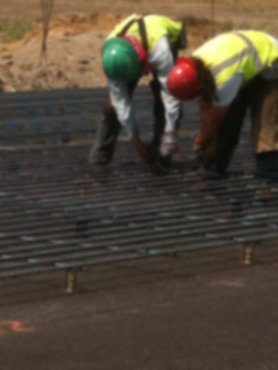 Our rodbusters tying CRCP Paving rebar