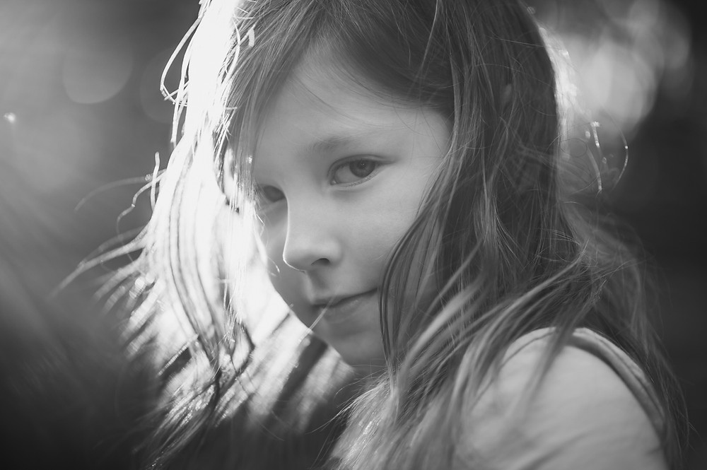 black and white portrait of a girl with backlight. documentary family photography melbourne