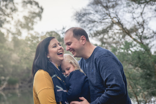 family of three laughing - lifestyle photo