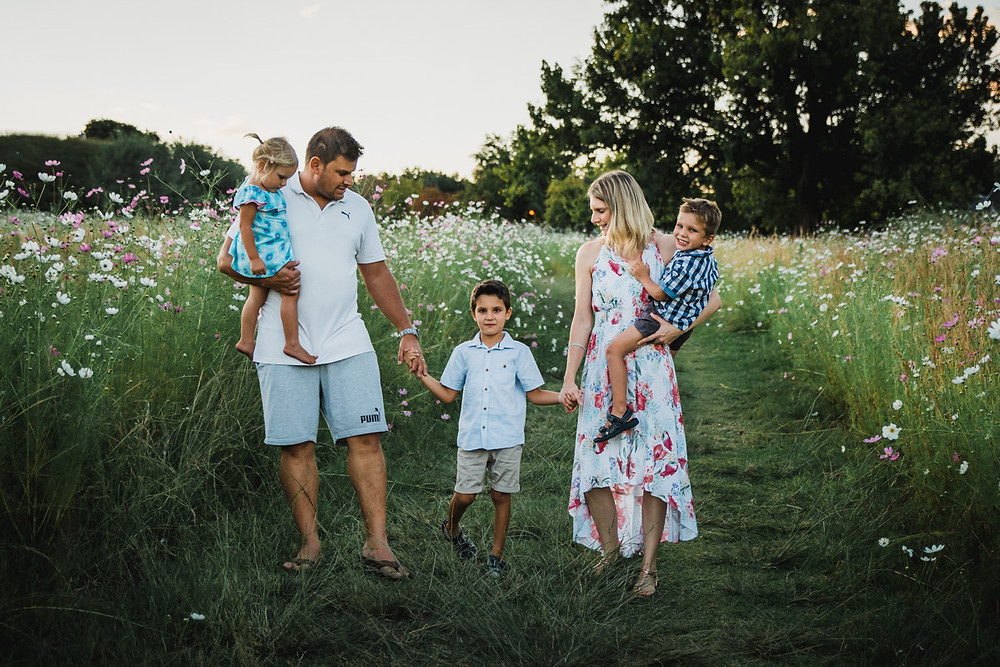 family of five walking in field of flowers - outdoor lifestyle photography session melbourne