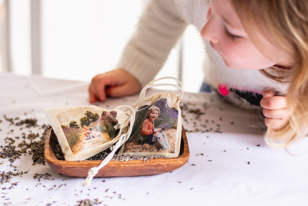 Scented bags with photo transfer decal, looked at by child