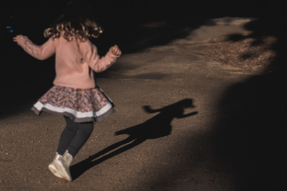 girl dancing with her shadow. documentary family photography melbourne