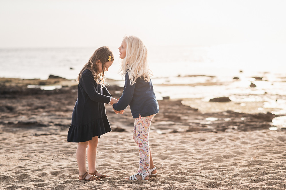 lifestyle portraits of children on the beach at golden hour - outdoor family photography Melbourne bayside photography