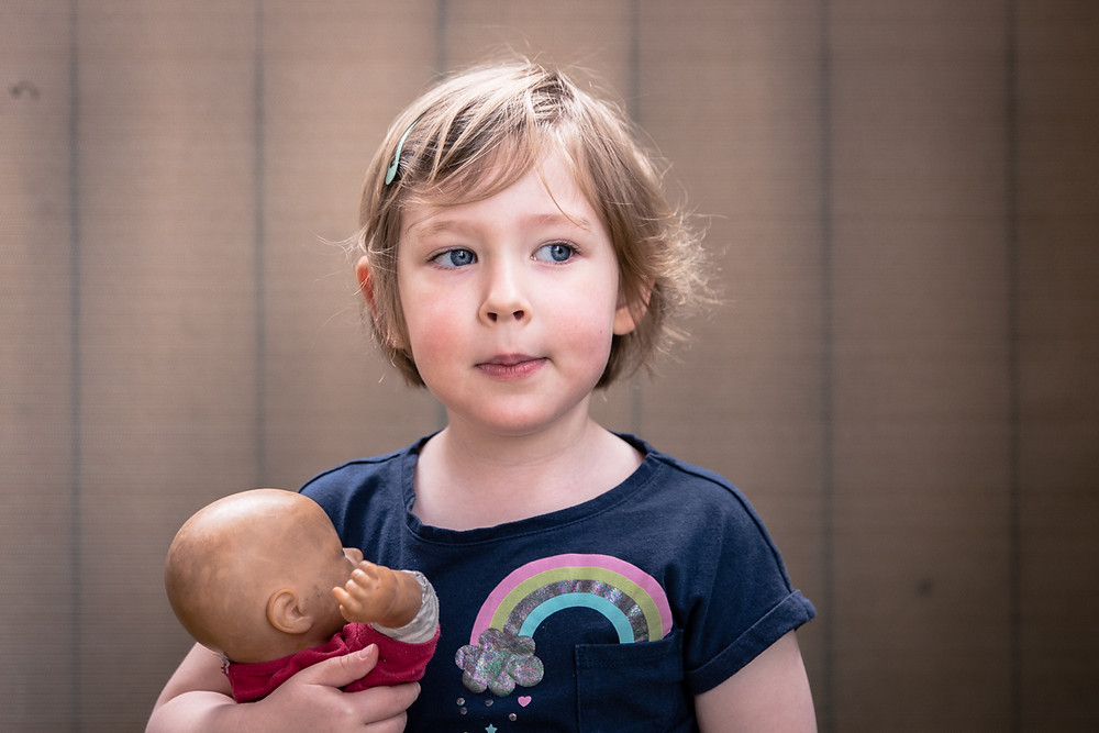 portrait of child holding a doll - melbourne school photography