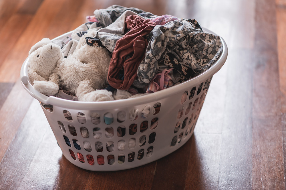 laundry basket with clothes and soft bunny toy. documentary family photography melbourne