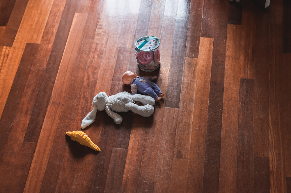 toys scattered on a wooden floor. documentary family photography melbourne