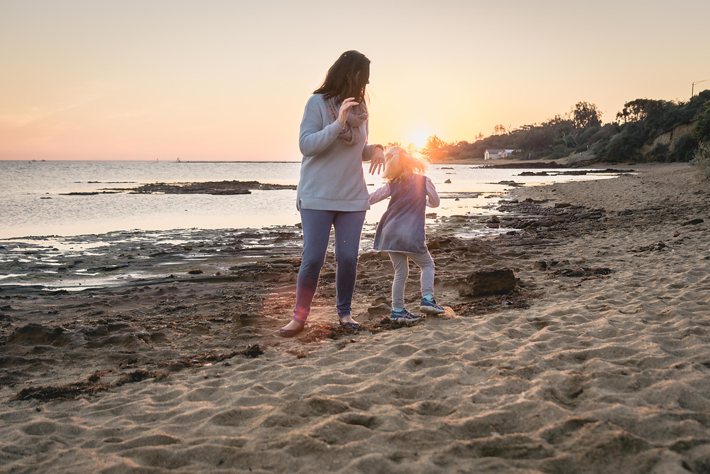 lifestyle mother and daughter portrait dancing on the beach at golden hour - outdoor family photography Melbourne bayside photography