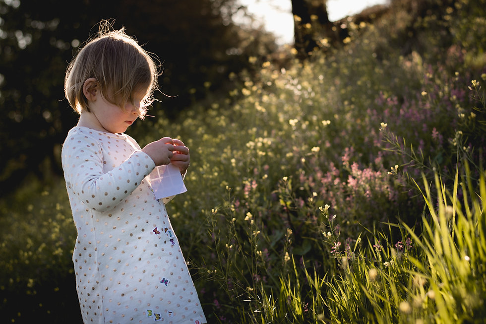 lifestyle portrait of child in flowers