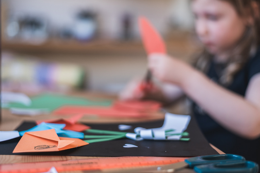 child crafting with paper. Close up of paper craft. Melbourne documentary photography