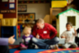Parents join circle time at co-op