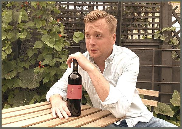 Mike Turner with a bottle of La Rose Gar
