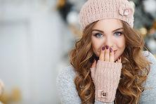 beautiful woman in warm clothing on chri