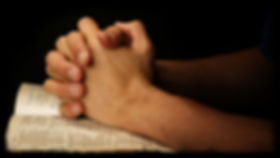 praying-hands-on-scripture_edited.jpg