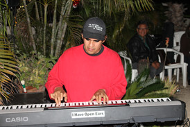 Diego jamming at a Christmas Party