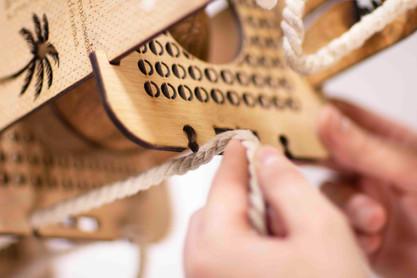Detaching Rope from Shelf Piece