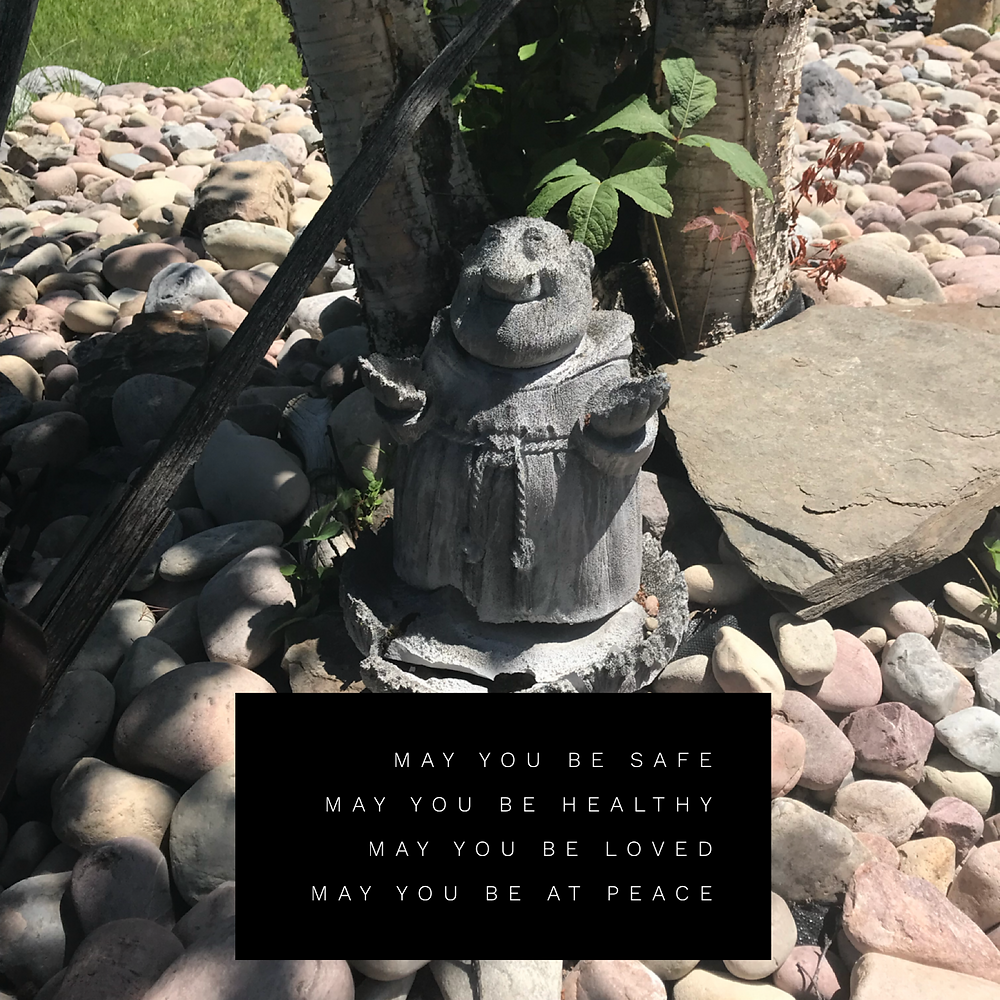 The monk in my back yard rock garden.
