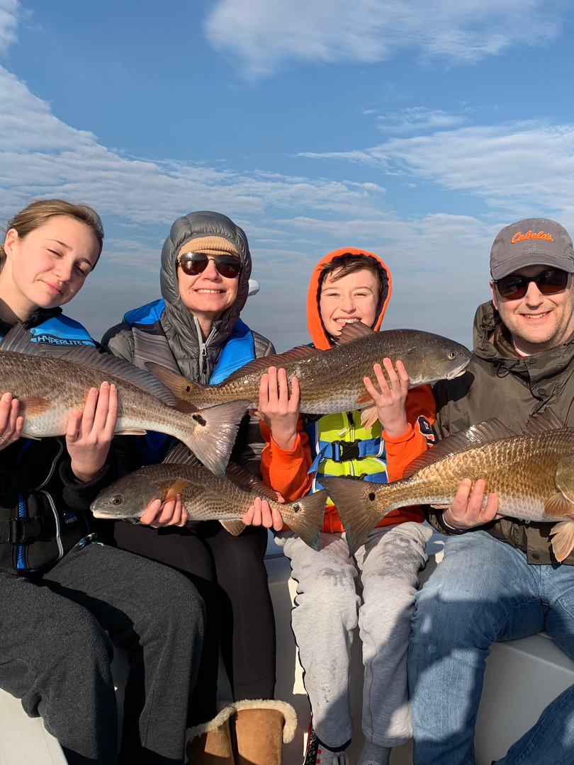 Family of Four With Redfish.jpeg
