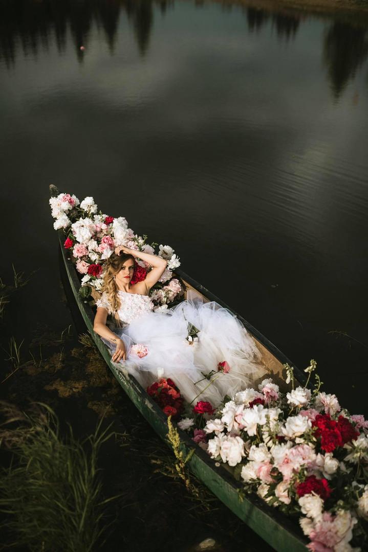 Bride in canoe full of peonies, Styled Shoots Across America