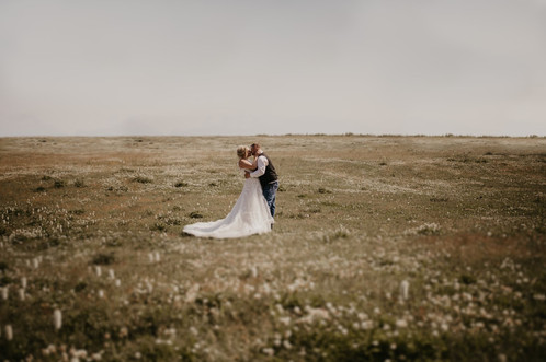 Bride and Groom in field of clover